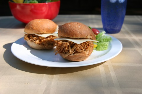 Pulled Barbecue Chicken Sandwich on plate with green salad